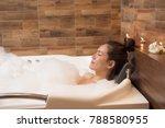 bathing woman relaxing in bath... | Shutterstock . vector #788580955