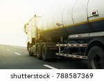 gas or oil truck on road