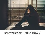 depressed women sitting head in ... | Shutterstock . vector #788610679
