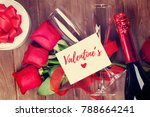 Stock photo valentines day greeting card champagne and red roses on wooden table top view with copy space 788664241
