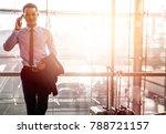 smart asian man using... | Shutterstock . vector #788721157
