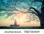 Male Teenager Sitting Alone On...