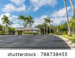 Small photo of Guard entrance road to gated community subdivision in South Florida