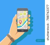 hand holding phone with map and ... | Shutterstock .eps vector #788762377