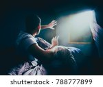 Small photo of Young man getting abducted by an UFO at night / high contrast image