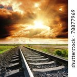 railway to cloudy sky at sunset - stock photo