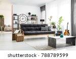 green vase in front of a dark...   Shutterstock . vector #788789599
