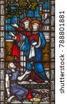 Small photo of LONDON, GREAT BRITAIN - SEPTEMBER 19, 2017: The apostles Peter and John heal of paralytic in front of Temple in Jerusalem on the stained glass in St Mary Abbot's church on Kensington High Street