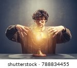 young man gazing at the glowing ... | Shutterstock . vector #788834455