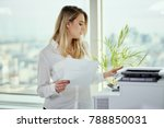 young businesswoman prints on... | Shutterstock . vector #788850031