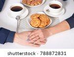 hands of couple drinking tea in ... | Shutterstock . vector #788872831