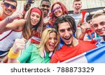 Small photo of Happy sport supporters having fun during football world game - Young fans at stadium before soccer match - Friendship, youth and against racism concept - Main focus on bottom guys