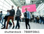 blurred people in a modern hall | Shutterstock . vector #788893861