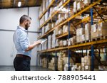 man warehouse worker with a... | Shutterstock . vector #788905441