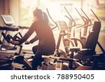 women exercise in a gym alone. | Shutterstock . vector #788950405