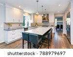 Stock photo luxury home interior boasts beautiful kitchen with custom white shaker cabinets endless marble 788979697