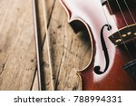 old violin with bow on a wooden ... | Shutterstock . vector #788994331