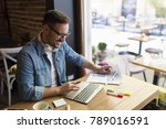 handsome freelancer working... | Shutterstock . vector #789016591