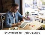 handsome freelancer working... | Shutterstock . vector #789016591