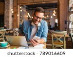 freelancer using phone while... | Shutterstock . vector #789016609