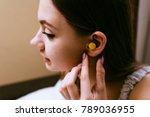 girl inserts earplugs getting... | Shutterstock . vector #789036955