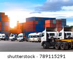 Industrial logistics and transportation of truck in Container yard for logistic and Cargo business plane at sunset - stock photo