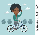 african american woman riding a ...   Shutterstock .eps vector #789116401