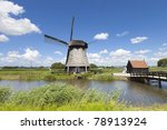 Dutch Windmill In A Fresh Gree...
