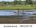 fisherman in a boat on a lake... | Shutterstock . vector #789155719