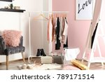 Stock photo collection of clothes hanging on rack in dressing room 789171514