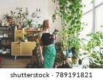 girl gardener with a cat in her ... | Shutterstock . vector #789191821