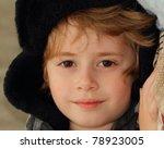 Portrait of a beautiful boy in winter hat. - stock photo