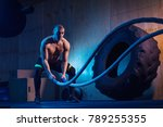 man with battle ropes exercise... | Shutterstock . vector #789255355