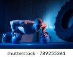 man with kettlebell weights... | Shutterstock . vector #789255361