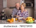 elderly couple in the kitchen... | Shutterstock . vector #789273955