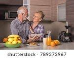 elderly couple in the kitchen... | Shutterstock . vector #789273967
