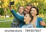 family taking selfie in park | Shutterstock . vector #789307837