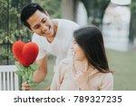romantic happy asian man give... | Shutterstock . vector #789327235