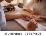 hands of qualified manicurist... | Shutterstock . vector #789374605