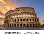 Small photo of Sunrise view of Colosseum in Rome, Italy. Rome architecture and landmark. Rome Colosseum is one of the main attractions of Rome and Italy