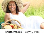 Woman Lying In A Field With A...