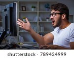 young man staying late in... | Shutterstock . vector #789424999