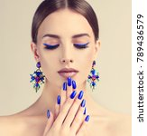 beautiful model girl with blue  ... | Shutterstock . vector #789436579