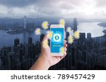 hand holding smart phone with... | Shutterstock . vector #789457429