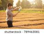 farmer researching plant in...   Shutterstock . vector #789463081