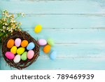 colorful easter eggs in nest... | Shutterstock . vector #789469939
