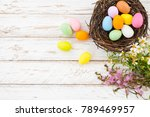 colorful easter eggs in nest... | Shutterstock . vector #789469957