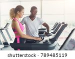 fitness instructor helps young... | Shutterstock . vector #789485119