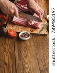 man cutting rack of lamb on... | Shutterstock . vector #789485197