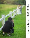 Wedding Photographer In Action...